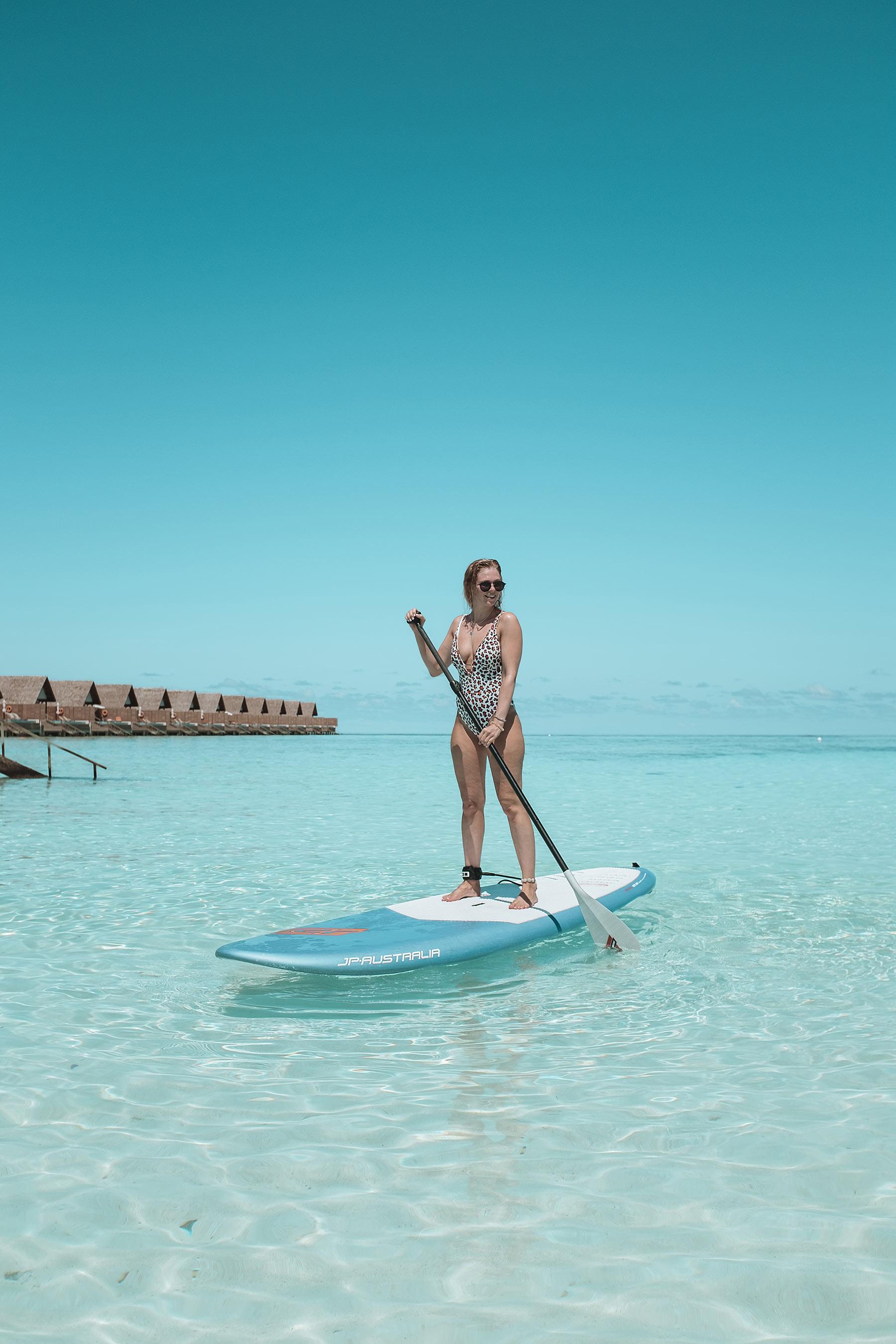 standup paddling faarufushi maldives travel blogger sunnyinga