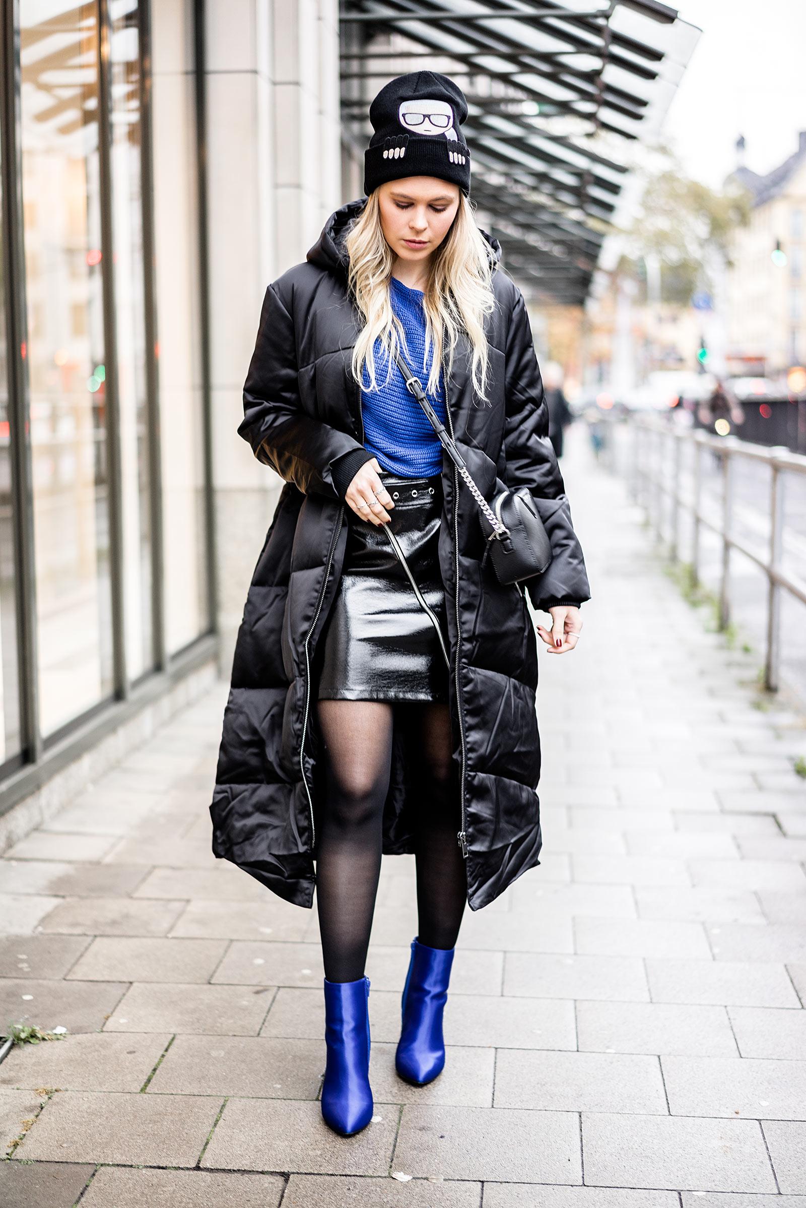 Sunnyinga Fashion Bloggerin Daunenmantel Outfit schwarz blau kombinieren